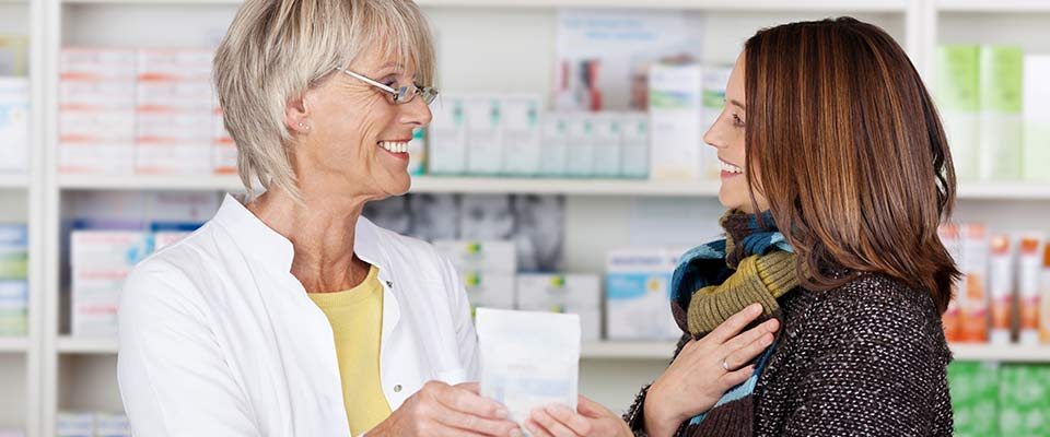 Lethbridge pharmacist helping customer